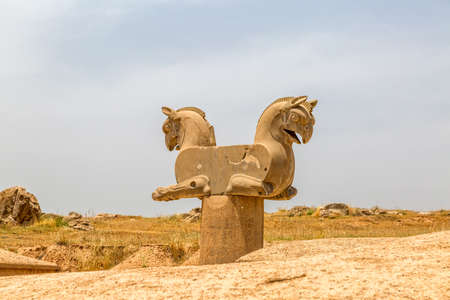 Sculpture of a Homa Bird in Persepolis, Iran. Two eagle-griffin capital has given the inspiration for the logo of Irans National Airline Homa.