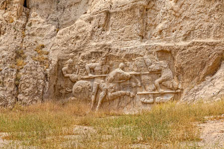 Ancient relief of the necropolis Naqsh-e Rustam that shows the equestrian battle of king Hormizd II.