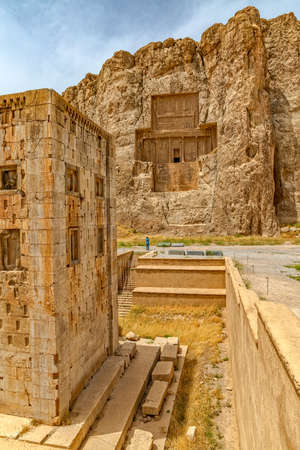 Naqsh-e Rustams historical monument Cube of Zoroaster is enigmatic structure and one of many surviving examples of the Achaemenid architectural design. 스톡 콘텐츠