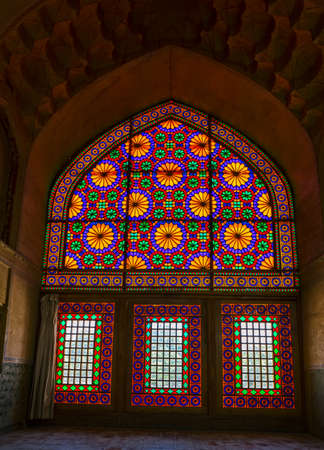 View of the old coloured glass windows from inside of the old citadel Karmin Khan in the centre of the Shiraz city. 스톡 콘텐츠