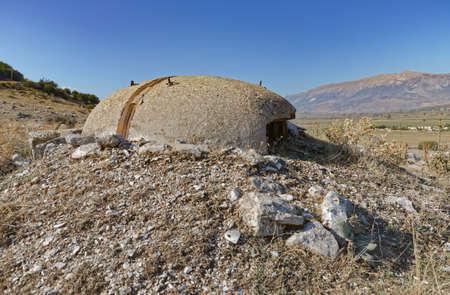Concrete military bunker ruins built in communist era Albania