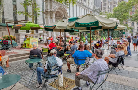 People listen to an outdoor concert in Bryant Park, New York
