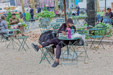 The woman is asleep in Bryant Park, New York