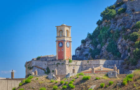 Old clock tower at Venetian fortress in Corfu town Greece