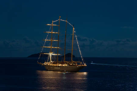 Night scene of a moonlight on the sea and the yacht anchored infront of Dubrovnik, Croatia. Zdjęcie Seryjne