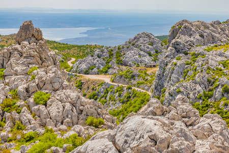 Velebit mountain wild road scene in summer time