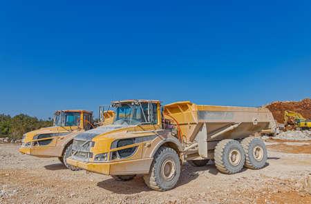 Big trucks at a road construction site