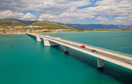 Aerial view of a long bridge above a sea, island Ciovo in Croatia