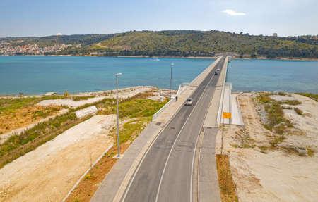 Aerial top view of a long bridge above a sea, island Ciovo in Croatia