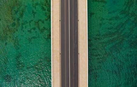 Aerial top view of a long bridge above a sea Zdjęcie Seryjne