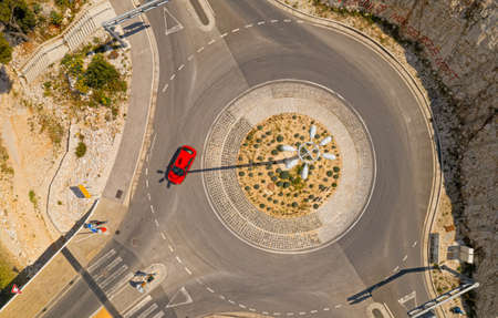 Aerial top view of a roundabout on island Ciovo in Croatia