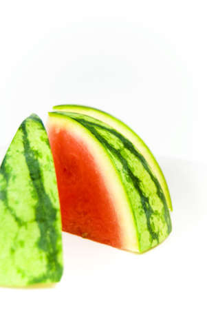 Sliced sweet summer watermelon against white background