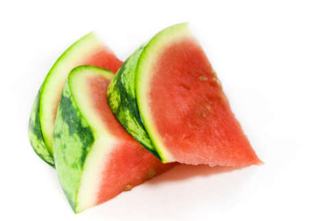 Delicious sweet slices of summer watermelon against white