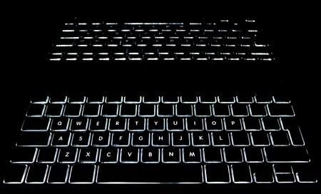 backlit keyboard: Keyboard with full alphabet backlit with reflection in dark screen