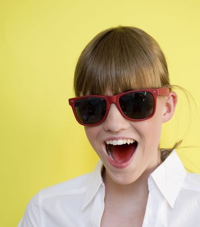 nouse: Cute girl plays with sunglasses Stock Photo