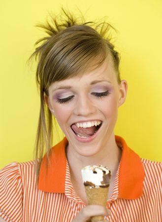 nouse: Cute girls enjoys eating an ice cream Stock Photo