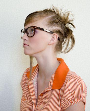 nouse: Cute girl wears designer glasses on light background