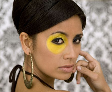 nouse: Beautiful Asian model with strong make-up and retro wallpaper