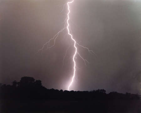 streak lightning: Lightning bolt striking horizon Stock Photo