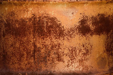 oxidized: Textured pattern of red rust on a metal barrel Stock Photo