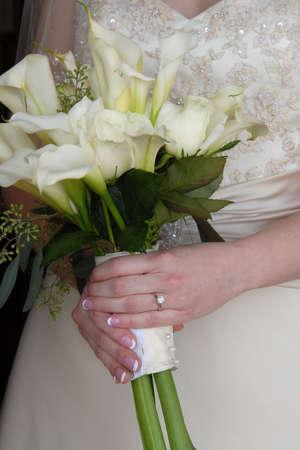 Bride holding live bouquet of flowers