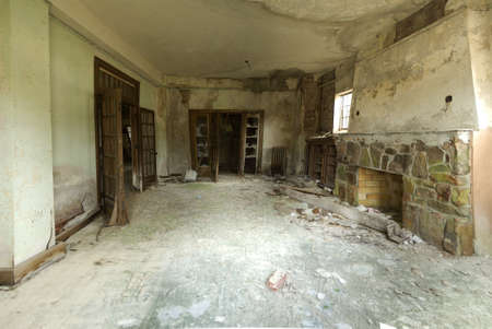 forsaken: Wide angle view of a dilapidated room in abandoned building  Stock Photo