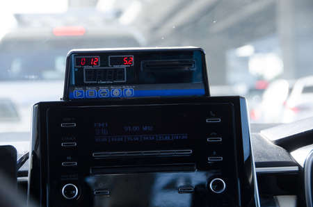The instrument panel displays the taxi fare meter