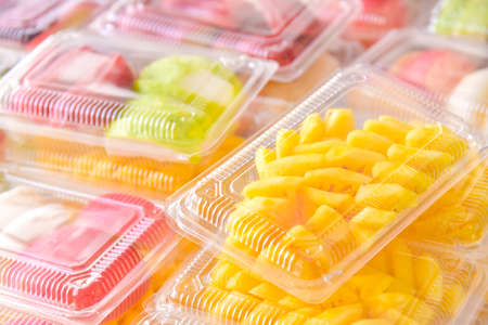 Colorful fruit in a clear plastic box