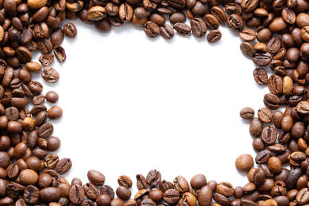 Coffee beans texture with copy space on white background. Top view of roast grains.