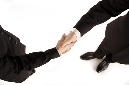 staffing: business man shaking hands with a business woman