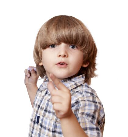 lack of confidence: A shouting boy is pointing forward; isolated on the white background  Stock Photo