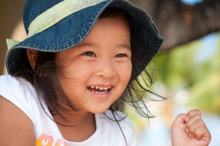 Smiling little asian girl wearing a hat. Stock Photo - 8246006