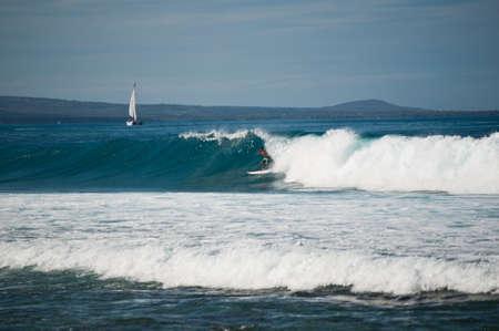 Kona, Hawaii - January 20, 2011 Surfer takes advantage of the big swells hitting the Kona Coast.