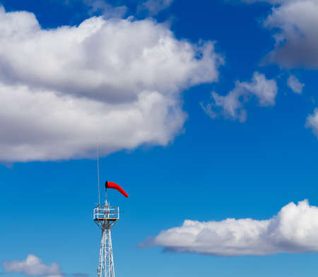 Bright Windsock Against a Vivid Blue Sky photo