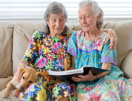 Two Elderly Ladies Reading A Book photo