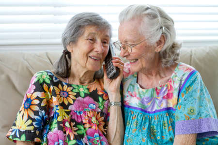 Two Elderly Ladies Talking On The Telephone