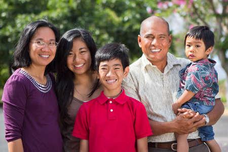 Happy ethnic island family. Stock Photo