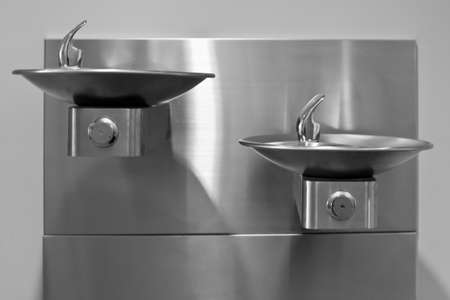 steel: Two Stainless Steel Drinking Fountains, front view  Stock Photo