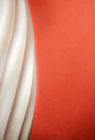 Abstract of a silver colored spiral border against a rusty orange background  Design draws the eye in while the orange provides lots of room for copy space