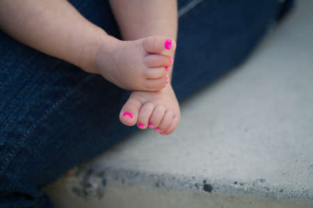painted toes: Baby girl feet with pink painted toe nails  Stock Photo