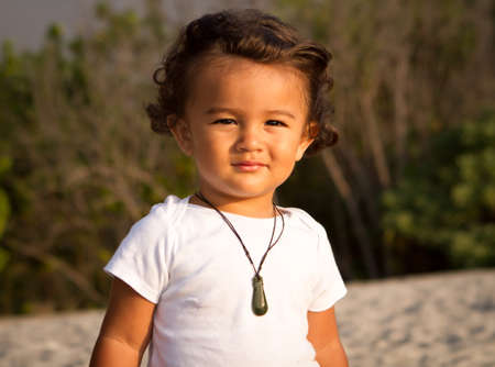 Toddler boy at the beach at sunset