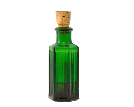 Old fashioned green chemical bottle. isolated on white photo