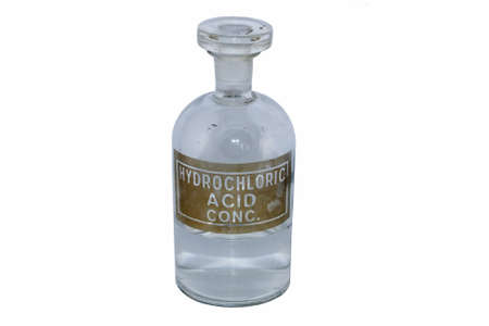 dispense: Hydrochoric acid in an old fashioned chmeical bottle, isolated on white Stock Photo