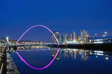 Millenium Bridge between Newcastle upon Tyne and Gateshead, England, at Night photo