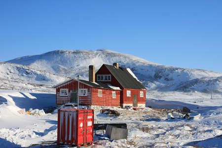 Arctic housing in winter, Ilimanaq, Greenland Stock Photo - 10008796