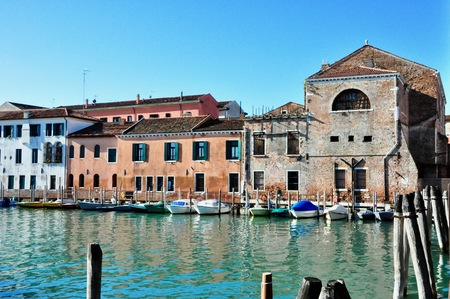 Non touristic part of Venice with empty silence colorful buildings, windows, streets and boats Stock Photo