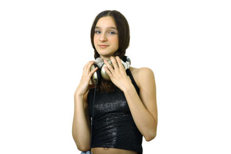 teenager smiling girl with headphones listen music isolated over white Stock Photo - 656730