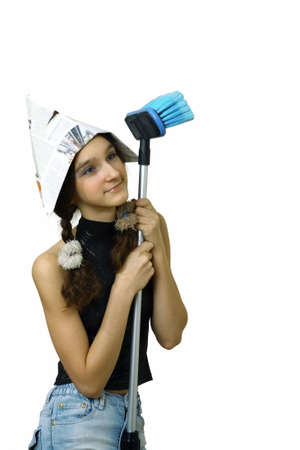 homebuyer: young smiling girl teenager in hat use brush for washing or painting white wall