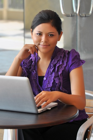 Businesswoman with lovely smile with laptop photo