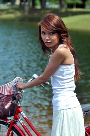 pretty girl with bicycle at the park  photo